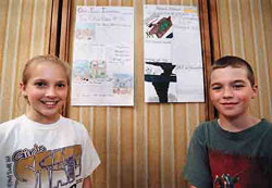 As part of a class project at Newell Elementary, Jordan Ramsey, 11, and Brett Rowley, 11, (right) created their own versions of the 1980 tornado edition of The Grand Island Independent. They said the actual papers took two-to-four days to make, but that they spent two-and-a-half weeks doing research along with their classmates.
